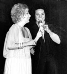 Vernon during show with presenter and        fashion show personality Anna Mascolo